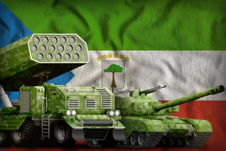 tank and rocket artillery with summer pixel camouflage on the Equatorial Guinea flag background. Equatorial Guinea heavy military armored vehicles concept. 3d Illustration
