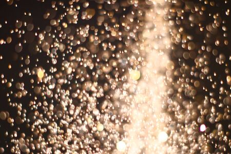 pretty huge amount flying festal glitters bokeh texture - abstract photo background Stock Photo