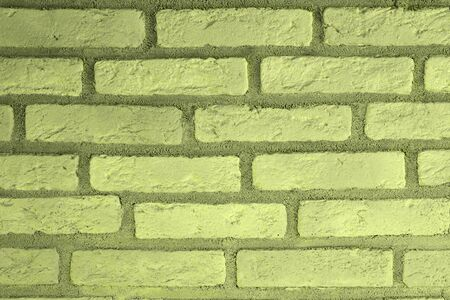pretty vintage yellow brick wall texture for use as background.