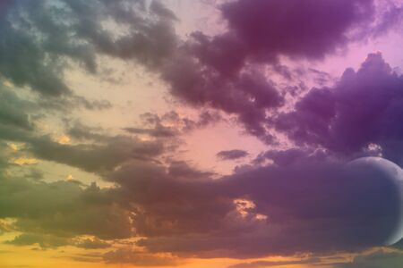 amazing unreal toned fantasy sun colored cloudy sky for using as background in design. Stock Photo