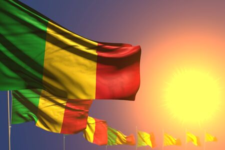 wonderful many Mali flags on sunset placed diagonal with bokeh and place for text - any feast flag 3d illustration