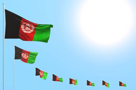 cute many Afghanistan flags placed diagonal on blue sky with place for text - any holiday flag 3d illustration