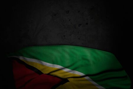 cute dark image of Guyana flag with large folds on black stone with free place for content - any holiday flag 3d illustration Zdjęcie Seryjne