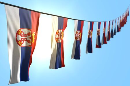 wonderful independence day flag 3d illustration  - many Serbia flags or banners hanging diagonal on rope on blue sky background with selective focus