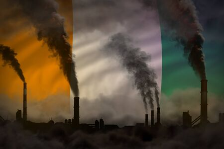 Dark pollution, fight against climate change concept - factory pipes heavy smoke on Cote d Ivoire flag background - industrial 3D illustration