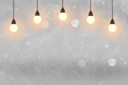 wonderful shining abstract background glitter lights with light bulbs and falling snow flakes fly defocused bokeh - festal mockup texture with blank space for your content