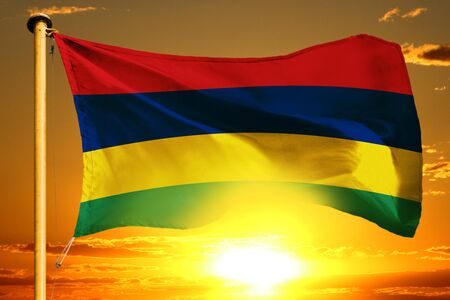 Mauritius flag weaving on the beautiful orange sunset background