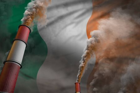 Pollution fight in Ireland concept - industrial 3D illustration of two huge plant chimneys with heavy smoke on flag background Reklamní fotografie