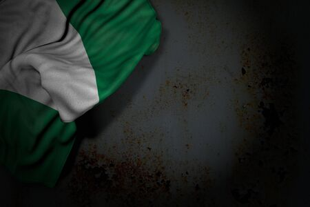 beautiful anthem day flag 3d illustration  - dark picture of Nigeria flag with big folds on rusty metal with empty place for text 版權商用圖片