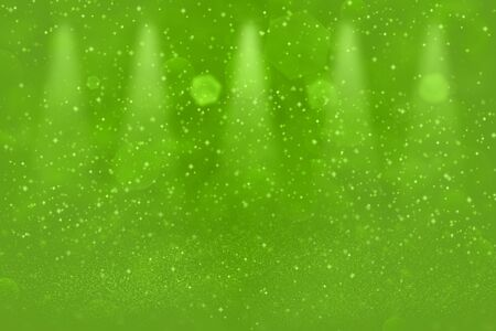 green wonderful brilliant abstract background stage spotlights with sparks fly defocused bokeh - festive mockup texture with blank space for your content