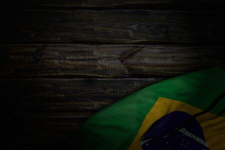 beautiful holiday flag 3d illustration  - dark picture of Brazil flag with large folds on old wood with empty place for your content 版權商用圖片
