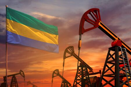 Gabon oil industry concept, industrial illustration. Gabon flag and oil wells and the red and blue sunset or sunrise sky background - 3D illustration
