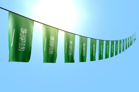 wonderful labor day flag 3d illustration  - many Saudi Arabia flags or banners hanging diagonal on string on blue sky background with bokeh