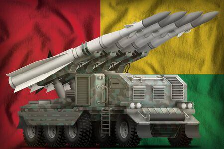 tactical short range ballistic missile with arctic camouflage on the Guinea-Bissau flag background. 3d Illustration