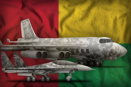 air forces with grey camouflage on the Guinea-Bissau flag background. Guinea-Bissau air forces concept. 3d Illustration Stockfoto - 129450621
