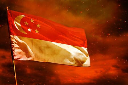 Fluttering Singapore flag on crimson red sky with smoke pillars background. Singapore problems concept. 写真素材