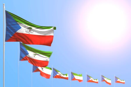 wonderful labor day flag 3d illustration  - many Equatorial Guinea flags placed diagonal with soft focus and free space for your content