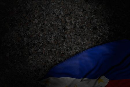 nice national holiday flag 3d illustration  - dark image of Philippines flag with large folds on dark asphalt with free place for your text