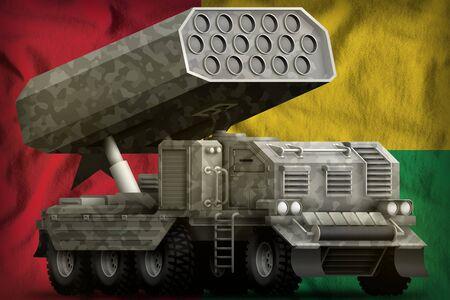 rocket artillery, missile launcher with grey camouflage on the Guinea-Bissau flag background. 3d Illustration