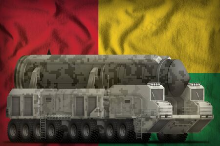 intercontinental ballistic missile with city camouflage on the Guinea-Bissau flag background. 3d Illustration 写真素材
