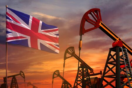 United Kingdom (UK) oil industry concept, industrial illustration. United Kingdom (UK) flag and oil wells and the red and blue sunset or sunrise sky background - 3D illustration