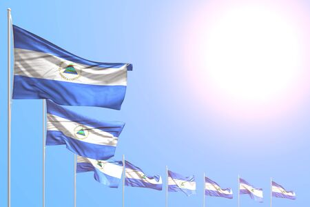 pretty independence day flag 3d illustration  - many Nicaragua flags placed diagonal on blue sky with place for content Imagens