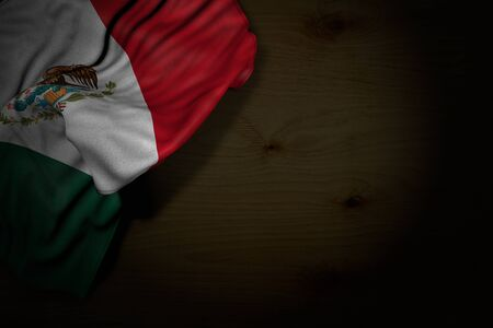 beautiful independence day flag 3d illustration  - dark image of Mexico flag with large folds on dark wood with free place for your content 版權商用圖片