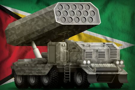 rocket artillery, missile launcher with grey camouflage on the Guyana flag background. 3d Illustration 版權商用圖片