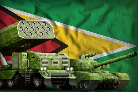tank and rocket launcher with summer pixel camouflage on the Guyana flag background. Guyana heavy military armored vehicles concept. 3d Illustration