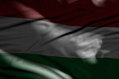wonderful photo of dark Hungary flag with folds lie in shadows with light spots on it - any celebration flag 3d illustration