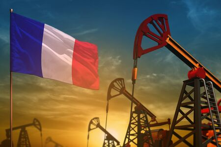 France oil industry concept, industrial illustration. Fluttering France flag and oil wells on the blue and yellow sunset sky background - 3D illustration