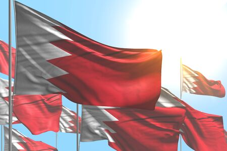 pretty many Bahrain flags are waving on blue sky background - any occasion flag 3d illustration