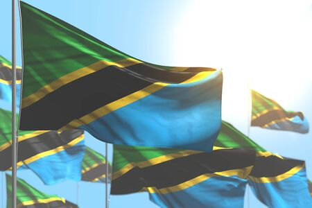 cute many Tanzania flags are waving against blue sky illustration with soft focus - any occasion flag 3d illustration  Banco de Imagens