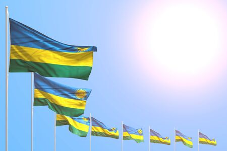 nice anthem day flag 3d illustration  - many Rwanda flags placed diagonal on blue sky with space for content Banco de Imagens