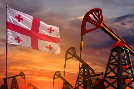 Georgia oil industry concept, industrial illustration. Georgia flag and oil wells and the red and blue sunset or sunrise sky background - 3D illustration