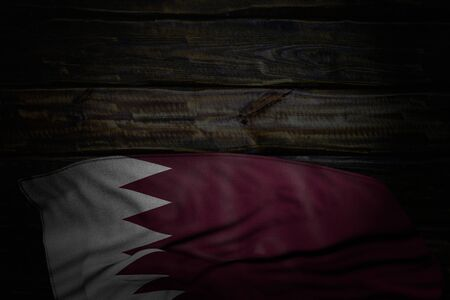 cute anthem day flag 3d illustration  - dark illustration of Qatar flag with big folds on old wood with empty space for your text
