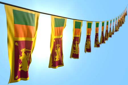 beautiful many Sri Lanka flags or banners hangs diagonal on string on blue sky background with selective focus - any celebration flag 3d illustration