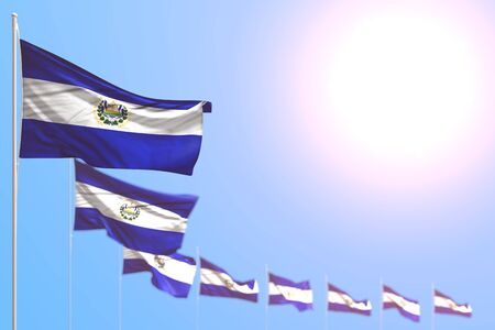 pretty many El Salvador flags placed diagonal with selective focus and free space for your text - any occasion flag 3d illustration