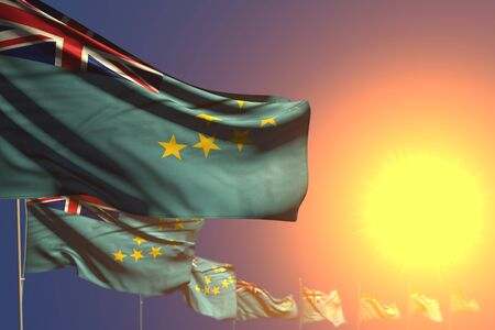 pretty many Tuvalu flags on sunset placed diagonal with bokeh and place for content - any feast flag 3d illustration