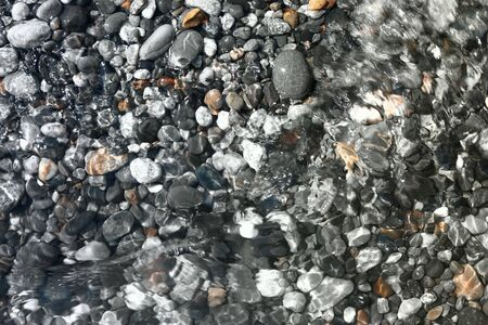 nice bright lake stones wet by wave texture - abstract photo background