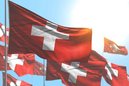 pretty any celebration flag 3d illustration  - many Switzerland flags are wave against blue sky image with bokeh