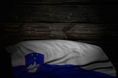 cute dark photo of Slovenia flag with big folds on old wood with empty space for text - any holiday flag 3d illustration