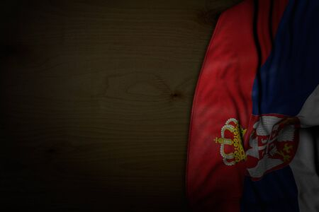pretty any occasion flag 3d illustration  - dark image of Serbia flag with big folds on dark wood with free place for content Imagens