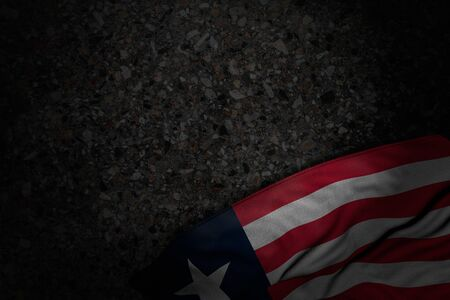 cute holiday flag 3d illustration  - dark photo of Liberia flag with big folds on dark asphalt with empty place for your content Imagens