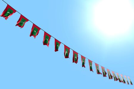 beautiful day of flag 3d illustration  - many Maldives flags or banners hanging diagonal on rope on blue sky background with bokeh Imagens