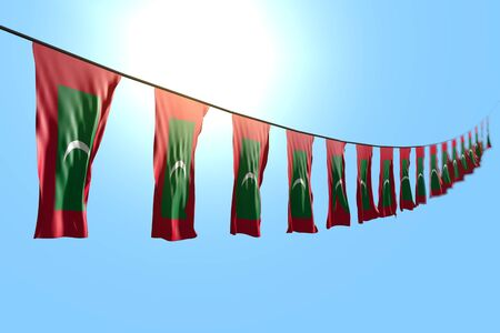 beautiful many Maldives flags or banners hangs diagonal on rope on blue sky background with soft focus - any occasion flag 3d illustration