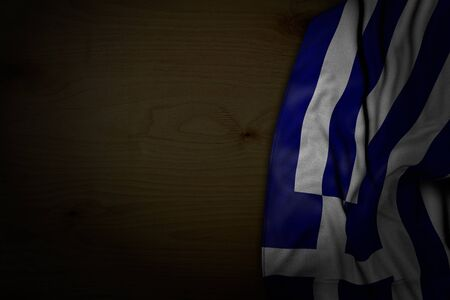 pretty dark picture of Greece flag with large folds on dark wood with free space for content - any feast flag 3d illustration