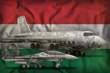 air forces with grey camouflage on the Hungary flag background. Hungary air forces concept. 3d Illustration