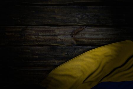 pretty dark illustration of Colombia flag with big folds on old wood with empty space for text - any holiday flag 3d illustration Stok Fotoğraf