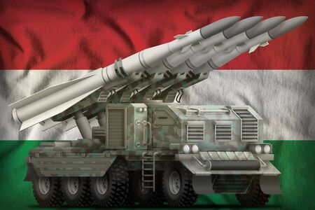 tactical short range ballistic missile with arctic camouflage on the Hungary flag background. 3d Illustration